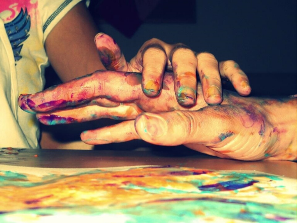 Two hands with paint on them.