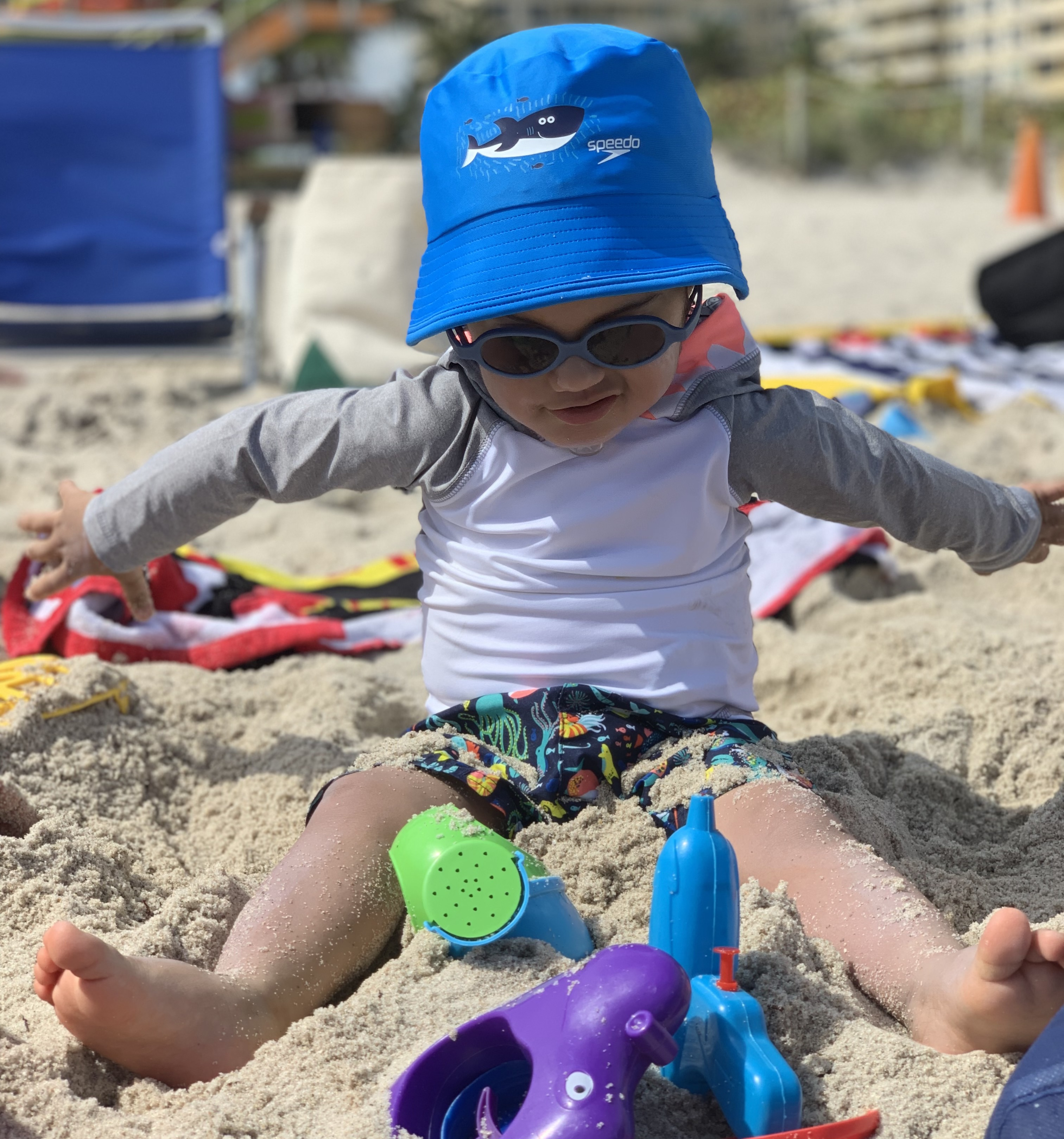 Jaxson playing in sand.