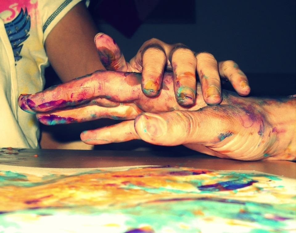 One painted hand over another.