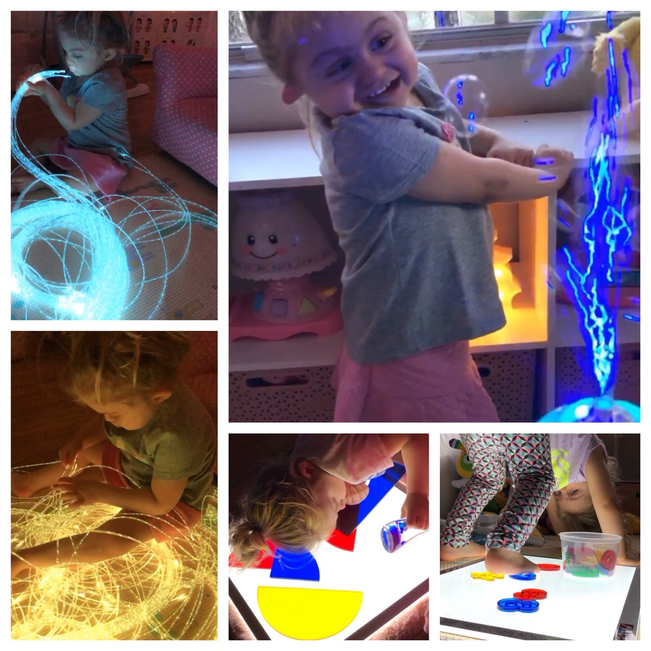 A girl plays with light strings and toys.